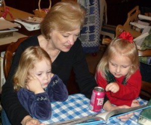 Mom reading to two granddaughters (Photo by C. M. Dennis, 12/2008)